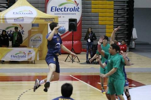 Australian junior Karl Warrener in the air throwing at goal against defenders