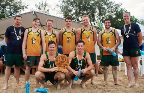 Australian youth beach handball team pose for a team photo