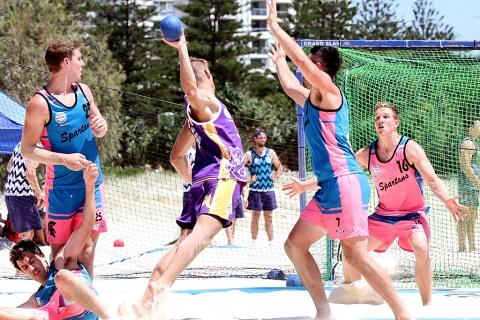 People playing beach handball