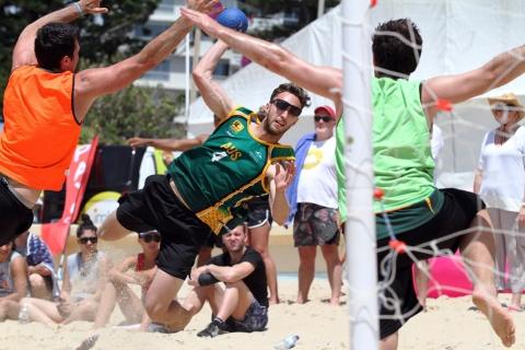 Beach handball player shoots at goal