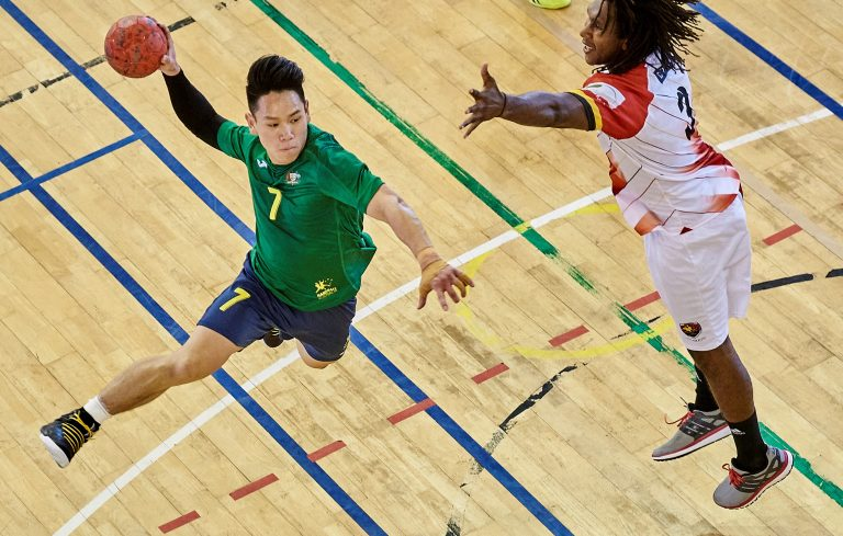 Above aspect of Australian junior male shooting goal past New Calenonian defenderplayer